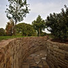 Pile On Style With a Dry-Laid Stone Retaining Wall