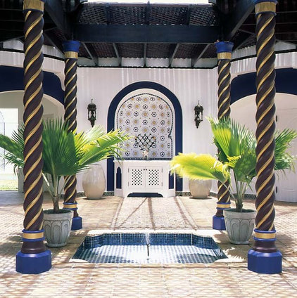 Tropical Patio by Bruce Palmer Interior Design