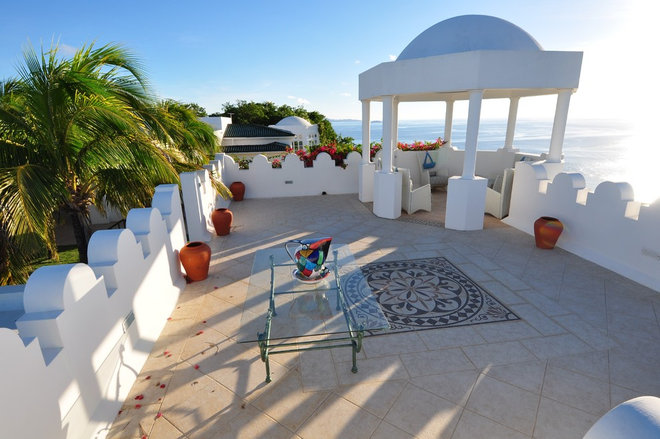 Mediterranean Patio by Designer Stone and Tile