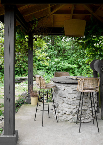 Eclectic Patio by Caroline Sharpnack