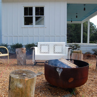 Example of a cottage chic patio design in New York with a fire pit