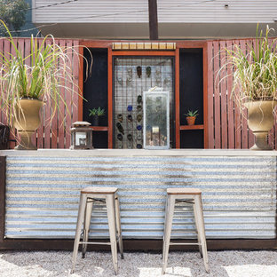 Patio container garden - industrial backyard gravel patio container garden idea in Los Angeles