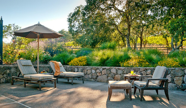 Traditional Patio by Blutter Shiff Design Associates. 10 Rock Wall Ideas for a Style Strong Patio