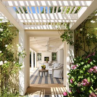 Patio - farmhouse patio idea in San Francisco with a pergola