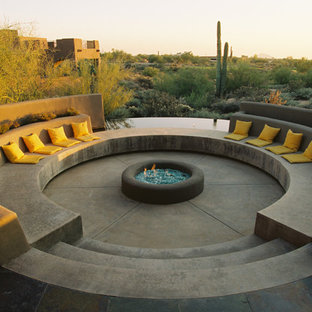 Example of a tuscan concrete patio design in Phoenix with a fire pit