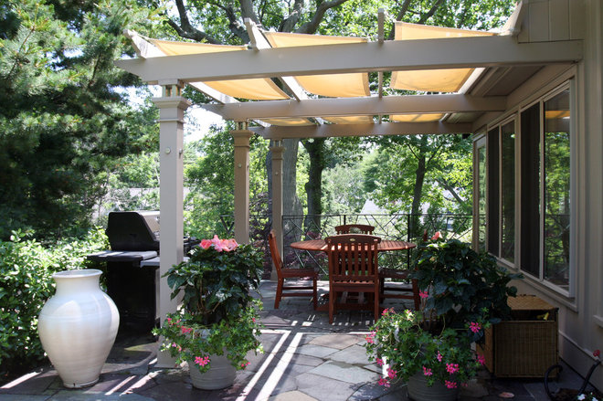 Eclectic Patio by Michael McCloskey Design Group