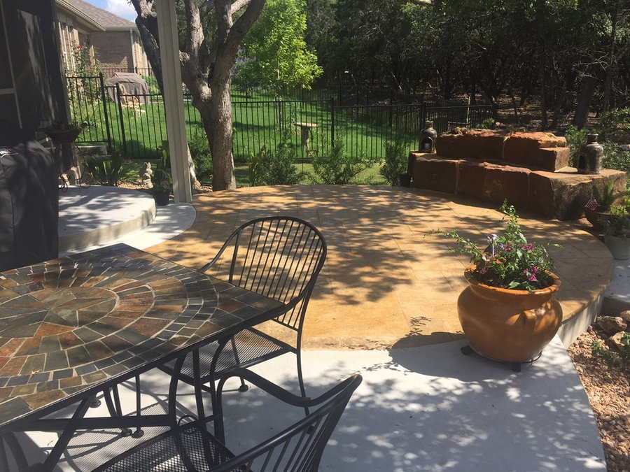 New concrete w/ stained leuders patio, large custom sandstone boulders