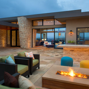 Patio - large contemporary backyard stone patio idea in San Diego with a fire pit and no cover