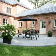 Traditional Patio by Melichar Architects