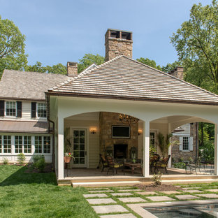 Inspiration For A Mid Sized Timeless Backyard Patio Remodel In Philadelphia  With A Fire Pit