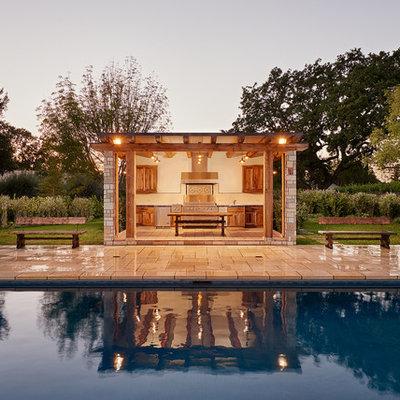 Patio kitchen - mid-sized rustic backyard stone patio kitchen idea in Santa Barbara with a gazebo
