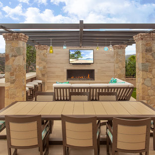 Design ideas for a mediterranean backyard patio in Orange County with an outdoor kitchen and a pergola.