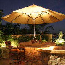 Mediterranean Patio by Illuminated Concepts Inc.