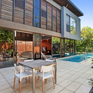 Inspiration for a contemporary side yard patio in Sunshine Coast with tile and no cover.