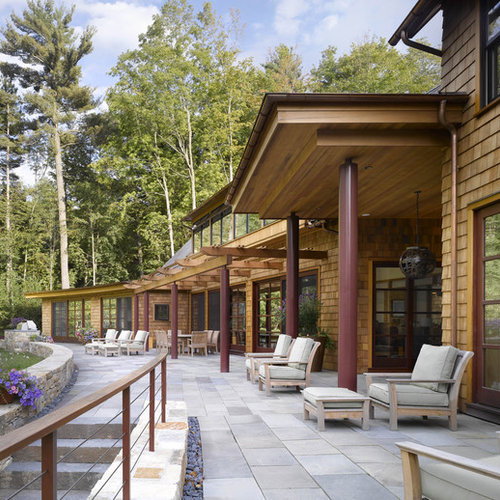Inspiration For A Contemporary Stone Patio Remodel In Burlington With A  Roof Extension