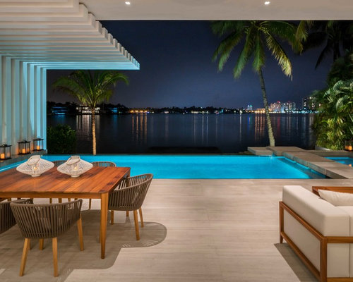 Inspiration For A Contemporary Backyard Tile Patio Remodel In Miami With Roof Extension