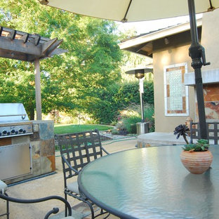 This is an example of a medium sized mediterranean back patio in San Francisco with an outdoor kitchen, decking and no cover.