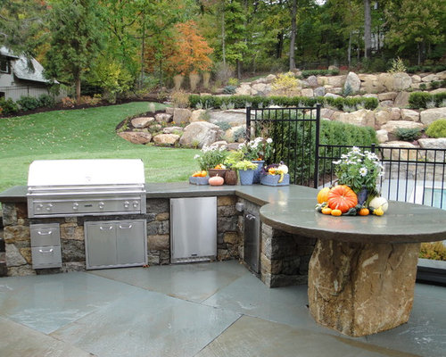 Mid Sized Elegant Backyard Stone Patio Kitchen Photo In New York