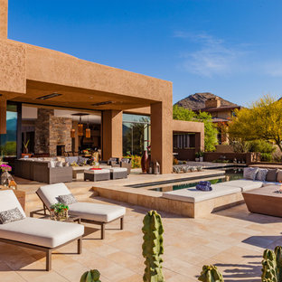 Inspiration for a southwestern backyard tile patio remodel in Phoenix with no cover