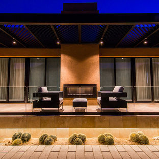 Design ideas for a contemporary courtyard patio in Phoenix with no cover.