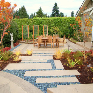 Large contemporary backyard patio in Seattle with concrete pavers, no cover and a vertical garden.