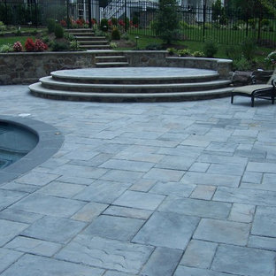 Example of a mid-sized eclectic backyard concrete paver patio design in DC Metro