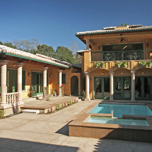 Inspiration for a mediterranean courtyard patio remodel in San Francisco with no cover
