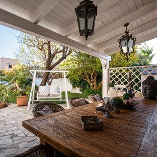 Foto de patio asiático, grande, en anexo de casas y patio trasero, con jardín de macetas y adoquines de piedra natural