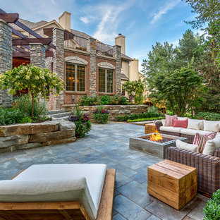 Mid Sized Elegant Backyard Stone Patio Photo In Detroit With A Pergola And  A Fire