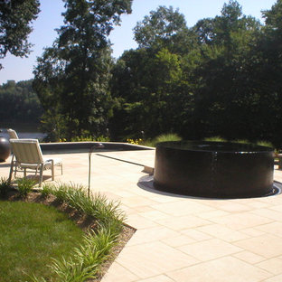 Inspiration for a mid-sized modern backyard tile patio fountain remodel in DC Metro with no cover