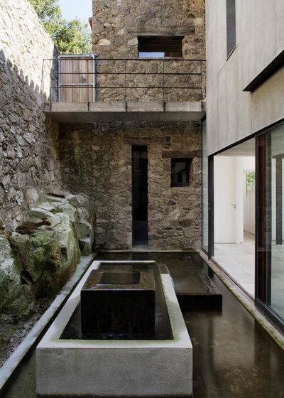 Casa de campo Patio by ÁBATON