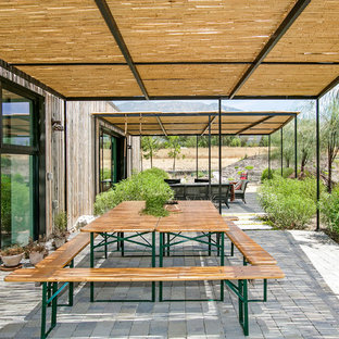 Photo of a country patio in Los Angeles with concrete pavers and a gazebo/cabana.