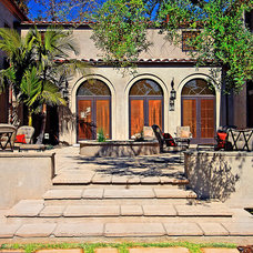 Mediterranean Patio by Tommy Chambers Interiors, Inc.