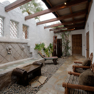 Stone patio fountain photo in Other with a roof extension