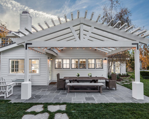 pergola 6 bedroom farmhouse. midsized country backyard stone patio photo in san diego with a pergola 6 bedroom farmhouse