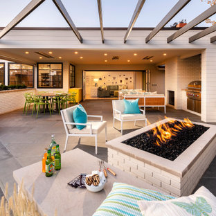 Inspiration for a huge transitional backyard tile patio remodel in Salt Lake City with a fire pit and a roof extension