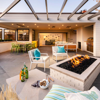 Inspiration for a huge transitional backyard tile patio remodel in Salt Lake City with a roof extension