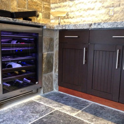 Open Air expansion - Outdoor Refrigerator, Outdoor wine cooler, Outdoor Beverage center, Outdoor Kitchen refrigerator, Stainless Beverage center, TRUE PROFESSIONAL SERIES, TRUE WINE COOLER all supported with heated marble floors. Notice the double laminate Azul Granite and Chisled Marble backsplash as finishing touches on this Great outdoor room designed and built by outdoor kitchen Designer Michael Gotowala founder of THE OUTDOOR KITCHEN DESIGN STORE by PREFERRED PROPERTIES. For more great idea outdoor kitchen ideas go to www.OUTDOORKITCHENDESIGNER.com