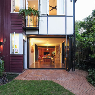 Inspiration for a mid-sized contemporary backyard patio in Brisbane with brick pavers and no cover.