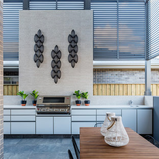 Inspiration for a large contemporary patio in Sydney with an outdoor kitchen and tile.
