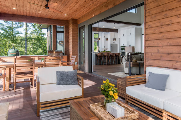 Rustic Patio by Living Stone Design + Build