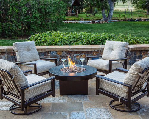 Small Rustic Backyard Stone Patio Idea In Denver With A Fire Pit