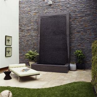 Patio fountain - contemporary patio fountain idea in Dallas