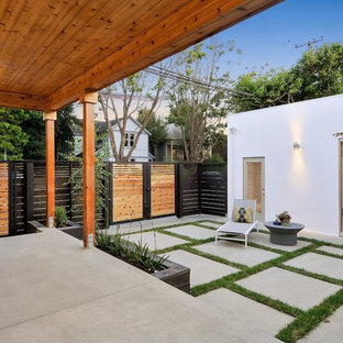 Example of a trendy backyard concrete patio design in San Francisco with a roof extension