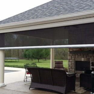Inspiration for a large timeless backyard concrete paver patio remodel in Louisville with a roof extension
