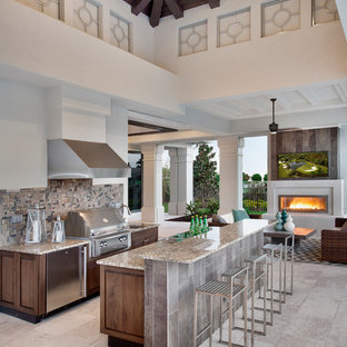 Inspiration for a timeless patio kitchen remodel in Miami with a roof extension