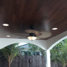 Tropical Patio by fx home improvements