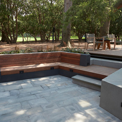 Example of a mid-sized trendy backyard patio design in New York with decking and no cover
