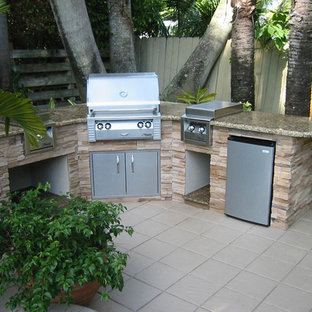 Mid-sized trendy backyard tile patio kitchen photo in Miami with no cover
