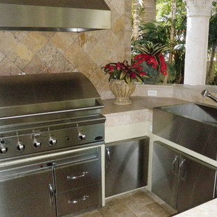 Inspiration for a mid-sized contemporary backyard stone patio kitchen remodel in Miami with a gazebo